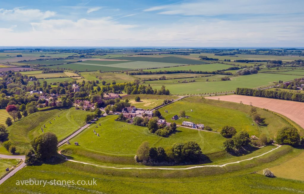 Aerial shot of the village of Avebury and its stone circles