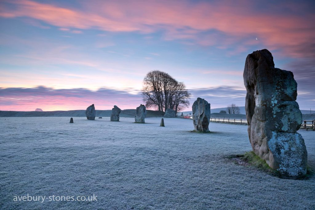 Avebury stone circles during winter with pink skies