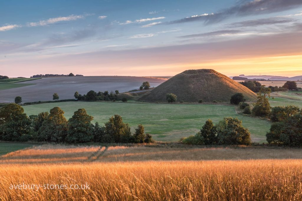 Silbury Hill at sunrise viewed from across the fields